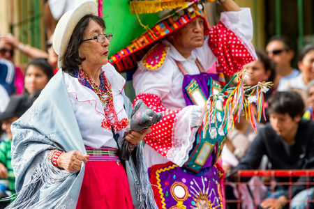 Banos De Agua Santa, Ecuador - 29 November 2014: Gray Pigeon Is Held By An Old Lady Waiting For Liberation On The Streets In Banos De Agua Santa, South America, Christmas Parade On November 29, 2014 Editorial