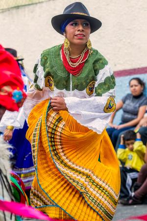 feast: Banos De Agua Santa, Ecuador - 29 November 2014:Indigenous woman dancer is dancing on the streets of Banos de Agua Santa, South America, Christmas Holiday On November 29, 2014 Editorial