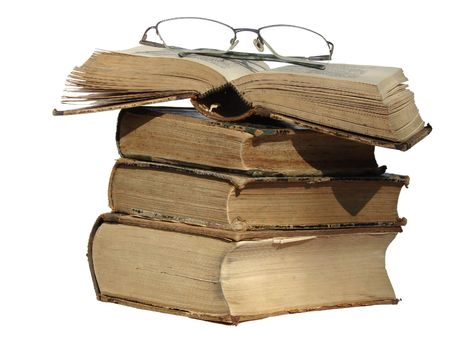 Old style vintage books with glasses on the top of them, isolated on white background with a clipping path.