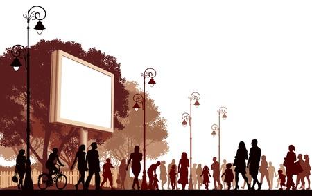 Multitud de personas caminando por una calle.
