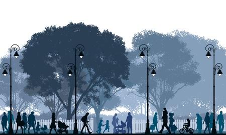 Foule de gens qui marchent dans une rue et dans un parc.