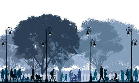 Crowd of people walking on a street and in a park.