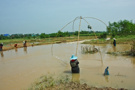 freshwater fishing: Water, a lot, and recharge the person bold, canal water, fish, fishermen, fishing, freshwater fishing in Thailand Editorial
