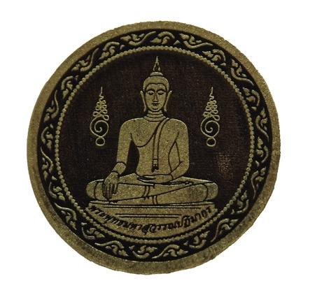 small image of Buddha , be worship with offerings of person respect , they have the belief that , these thing will have protected dangerous from the evil Stock Photo