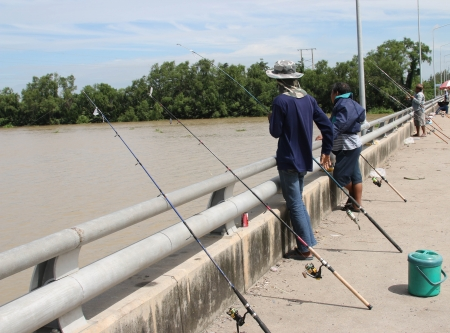 Fishing for a fish one by one. Is another sport that is popular with many people. Is both fun and exercise. photo