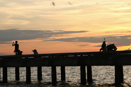 Jetty bridge was built as a cargo ship docks with fishing. Most fish are And seafood species A relaxing evening by Source Stock Photo - 28515485