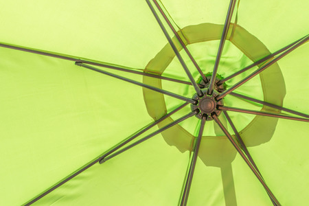 rounded edges: An umbrella for sun and rain. A long handle for carrying And the upper curved plate Like mushrooms rounded edges Made of paper or cloth An important characteristic of the umbrella. Can fold away