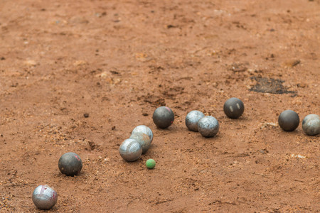 bocce ball: Petanque, croquet is played by a cast iron ball closer to the core (cochonnet) of wood as much as possible.