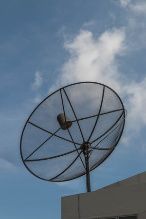 specifically: Satellite or satellite dish means. One antenna is specifically designed to fit the signal from the satellite. Floating in space and send signals back down to the ground slope Stock Photo