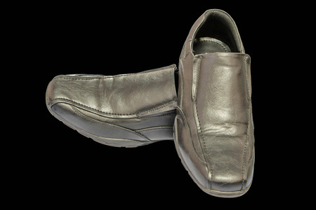 Shoe is a man used to the foot. To prevent damage caused by exposure to various surfaces. Or sore feet from walking or running. Stock Photo