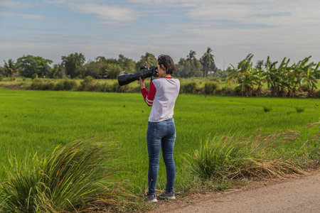 A photographer using a camera.