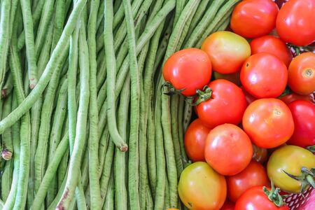 green Beans and tomatoes are prepared for cooking Фото со стока