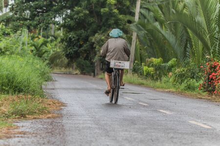 Man riding a bicycles in countryside road