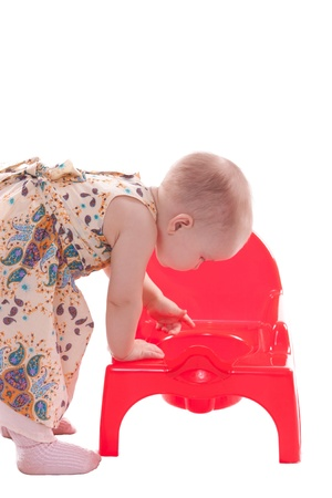 Little girl looking in potty photo