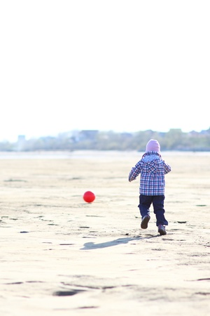Child running to ball Stock Photo - 13629435