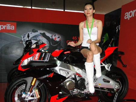 a pretty model on aprilia bike at kuala lumpur international motorshow, klcc 7.12.201 Stock Photo - 11117261