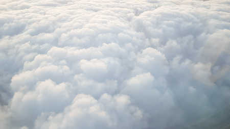 White Cumulonimbus cloud on the high altitude , view from aircraft Фото со стока