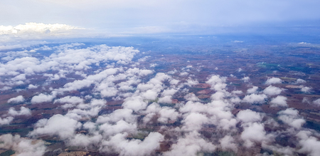 Stratus cloud aboce ground view from airplane