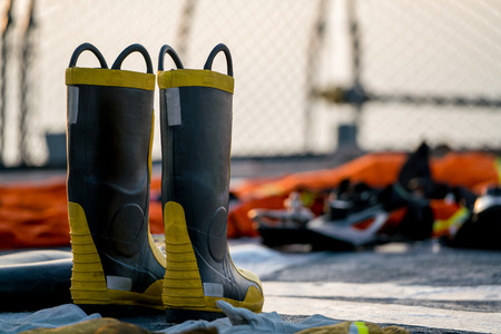 Fire fighting boots dry on the navy ship deck after used and cleaned