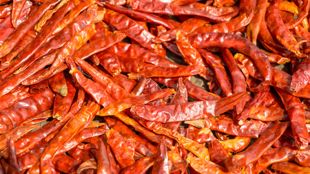 Dried red chillis are preserved by sunlight.