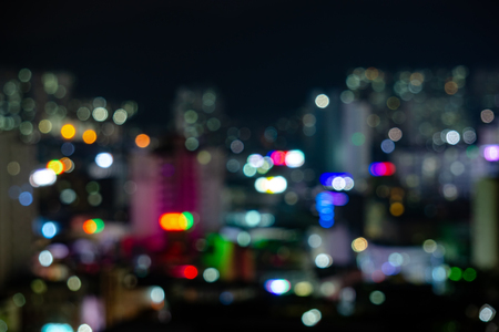 Blurred bokeh of various colour lights background of a cityscape at night