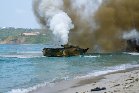 CHONBURI, THAILAND - FEBRUARY 17, 2018: Assault amphibious vehicles of South Korea land on sea shore during Cobra Gold 2018 Multinational Military Exercise on February 17, 2018 in Chonburi, Thailand. Sajtókép