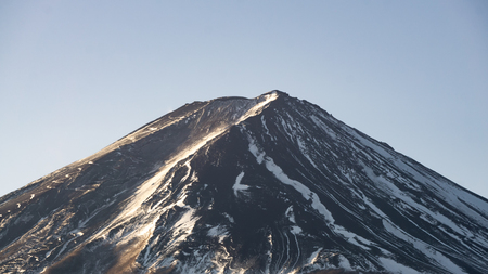 Mount Fuji with less snow on top of its peak. Fuji is a most famous mountain in Japan.