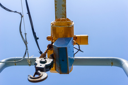 Hook and electrical winch use for lift or hanging things at outdoor dock. Stockfoto