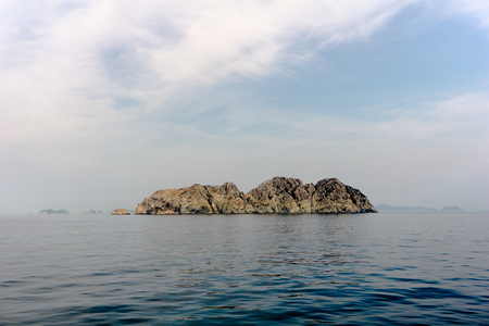 Unpopulated rock island in the sea far from main land