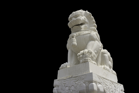 White marble Chinese guardian lion sculpture on black background 스톡 콘텐츠