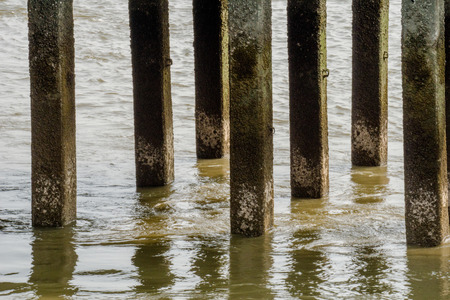 Foundation piles of pier make turbulence water flow or whirlpool in Chao Phraya river.
