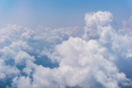 Cumulus cloud over the sky view from jet plane