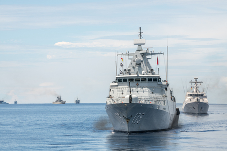 PADANG, INDONESIA - APRIL 16, 2016 : KD Kelantan, Kedah-class offshore patrol vessel of Royal Malaysian Navy sails among the other navies participating in Multilateral Naval Exercise Komodo 2016.