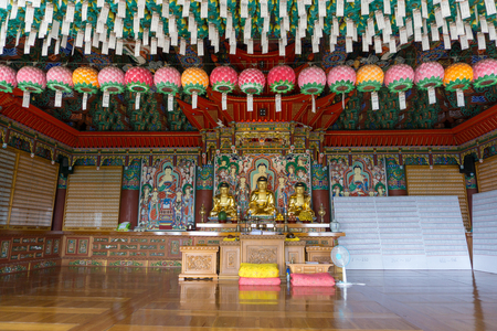BUSAN, SOUTH KOREA - JULY 20, 2017 :  Golden principle Buddha images in Main hall of Haedong Yonggungsa Temple on July 20, 2017 in Busan, South Korea.