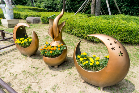 BUSAN, SOUTH KOREA - JULY 20, 2017 : Flowerpot made from copper alloy display in the public park in Haeundae Dongbaekseom Island on July 20, 2017 in Busan, South Korea.