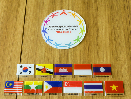 BUSAN,SOUTH KOREA - JULY 20, 2017: Symbol of ASEAN-Republic of Korea Commemorative Summit 2014,Busan and ASEAN countries flags hang on the wall in APEC House.Text under the flags are countries name. Editorial