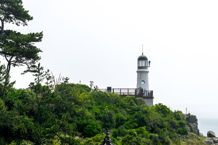 BUSAN,SOUTH KOREA - JULY 20, 2017: Old lighthouse on the hill of Haeundae Dongbaekseom Island on July 20, 2017 in Busan, South Korea.