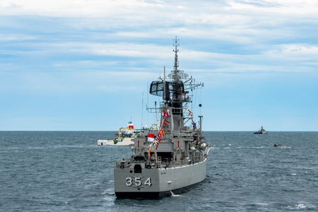PADANG, INDONESIA - APRIL 11, 2016 : KRI Oswald Siahaan (354), Ahmad Yani class corvette of Indonesian Navy anchors among the other navies participating in Multilateral Naval Exercise Komodo 2016.