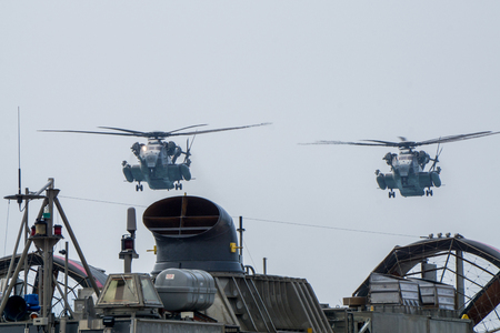 CHONBURI, THAILAND - FEBRUARY 17, 2018: Two CH-53 Sea Stallion heavy-lift transport helicopters of US. Navy fly over the LCAC during Cobra Gold 2018 Multinational Military Exercise.