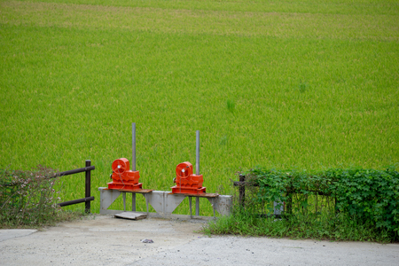 Red valves of water gate for irrigation system in paddy rice field. valves for open or close to control water in the rice paddy field. Stock Photo
