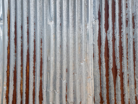 Old zinc alloy  ripple plate with rust, strain and dent. The stripe is in the vertical line.