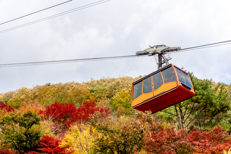 An aerial lift or cable car move up to the  Daedunsan mountain in Chungcheongnam, South Korea. Stock Photo