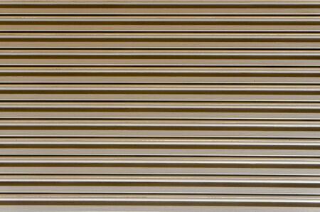 Plane view of straight line pattern of warehouses ripple shutter roller door Imagens