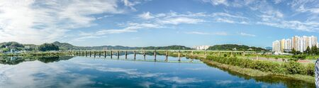 Beautiful panorama view of Andong bridge with  reflection in the water. Andong bridge is the new bridge across the Nakdong River in  Andong city Standard-Bild - 130629279
