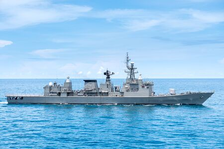 Guided missile frigate type navy ship sails in the sea to protect sea line of communcation or SLOC.