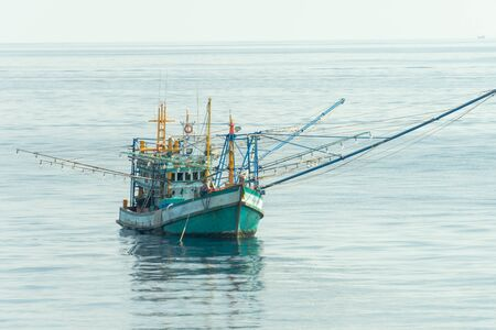 Thai fishing boat use boom and net to catch Schooling fish in the sea