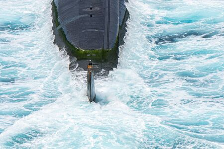 Stern of the high technology nuclear submarine of U.S.Navy above the sea surface.