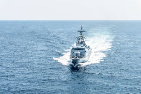 Modern patrol navy ship sails in the sea during territory patrol mission.Peace keeping operation sea patrol.