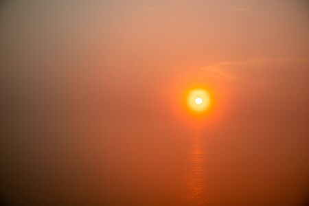 Abstract of Civil twilight when sunset in the sea wirh dust and water mist in the atmosphere.