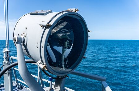 A searchlight or spotlight onboard the navy warship.